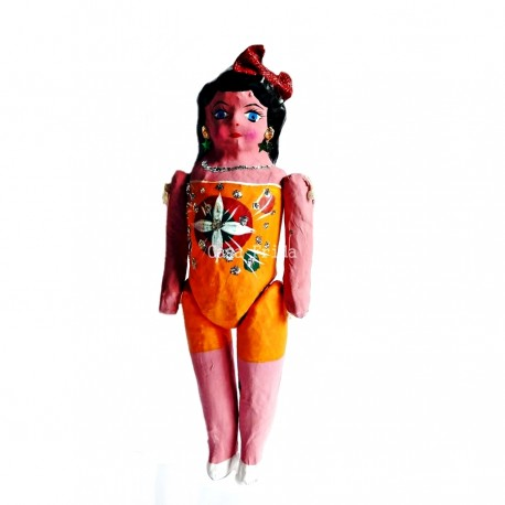 Orange paper maché doll